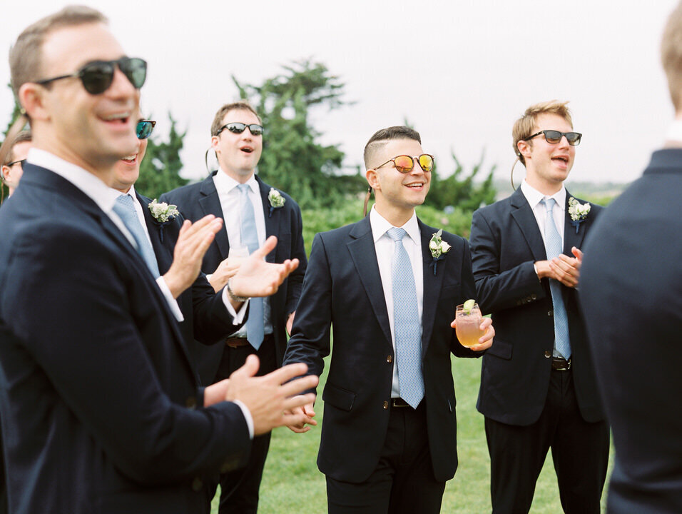 photos of groomsmen for wedding at newport castle hill