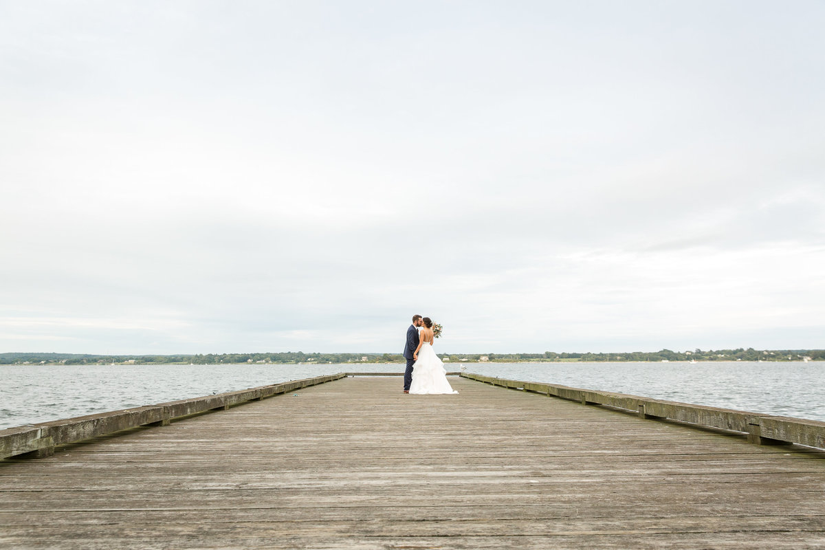 Bride and groom share some alone time out on the dock at Glen Manor House