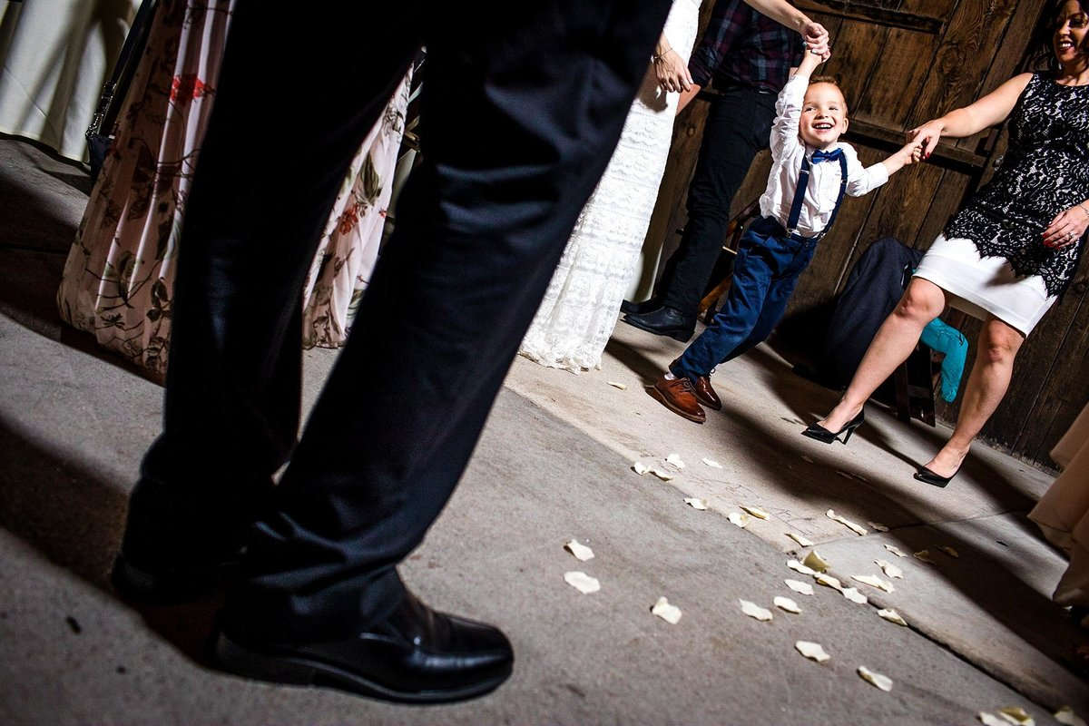 The ring bearer dances with guests at a San Diego wedding reception.