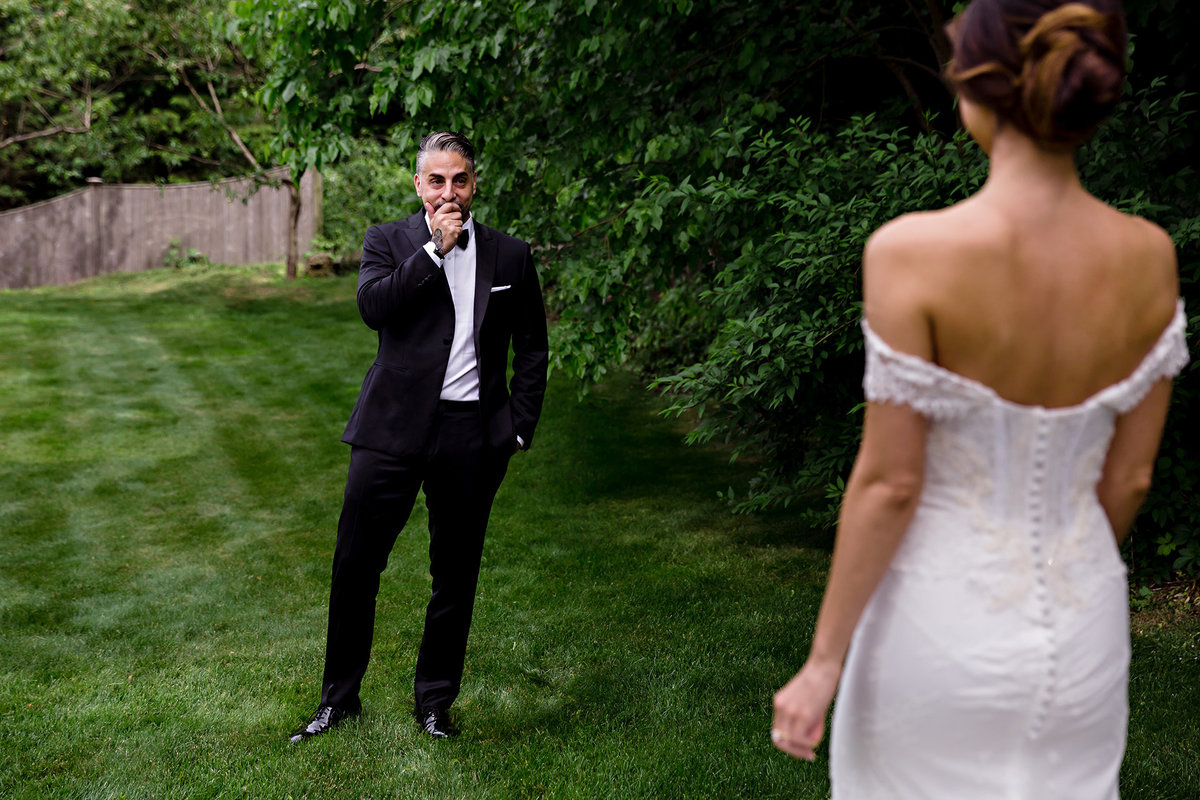 Peabody Essex Museum wedding the groom gets emotional during the couple's first look outside of Boston