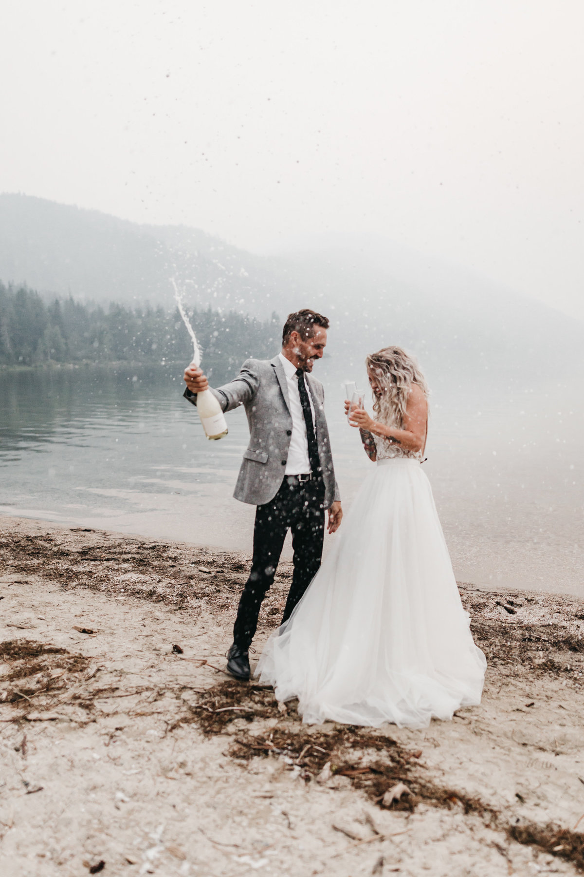 athena-and-camron-sara-truvelle-bridal-wenatchee-elopement-intimate-43-champagne-pop-bride-groom-fun