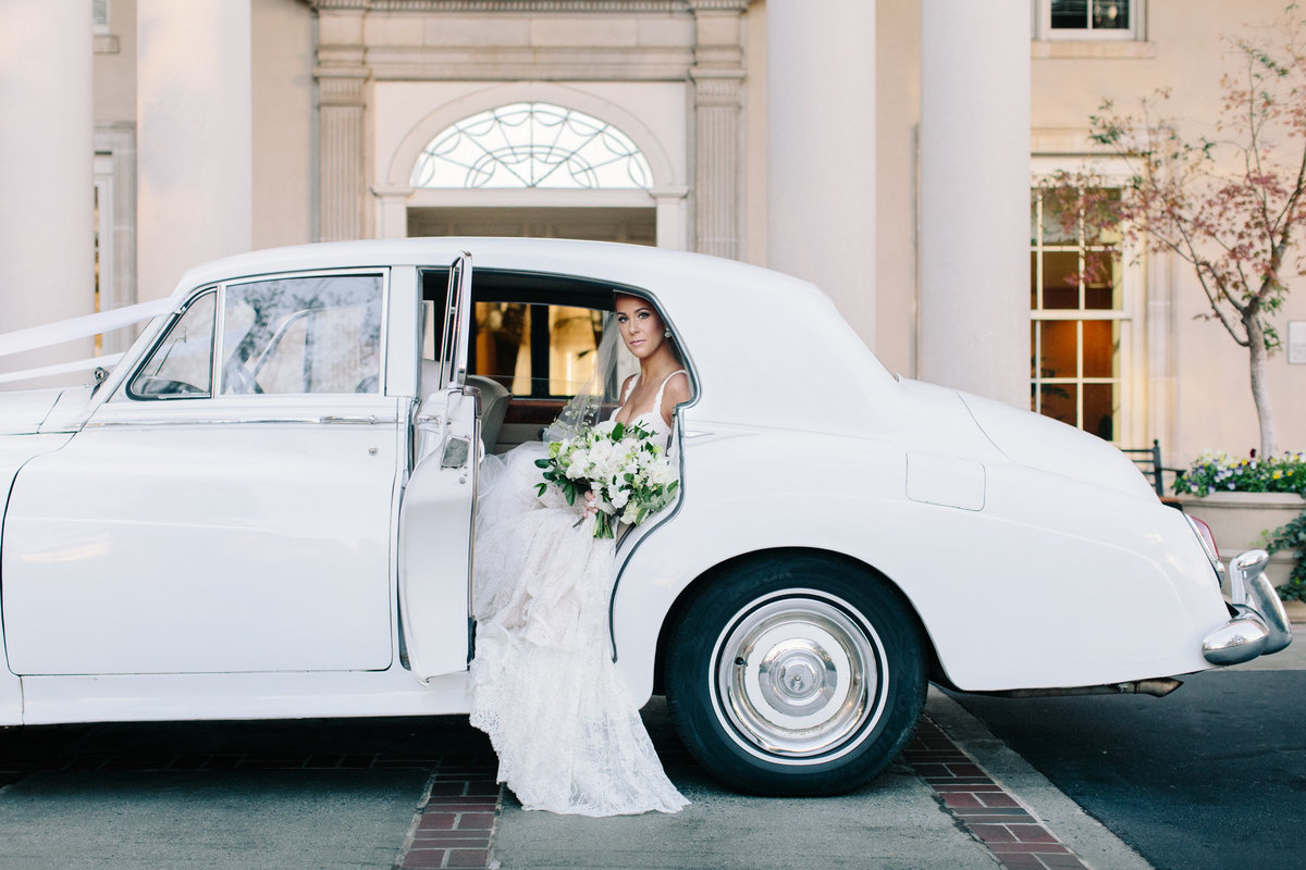Vintage get away cars at weddings can create a timeless look in your photos.  Real wedding at the Biltmore Atlanta captured by Rebecca Cerasani.