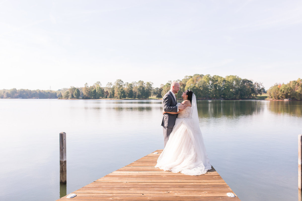 A bride and groom on the dock at Lake Anna