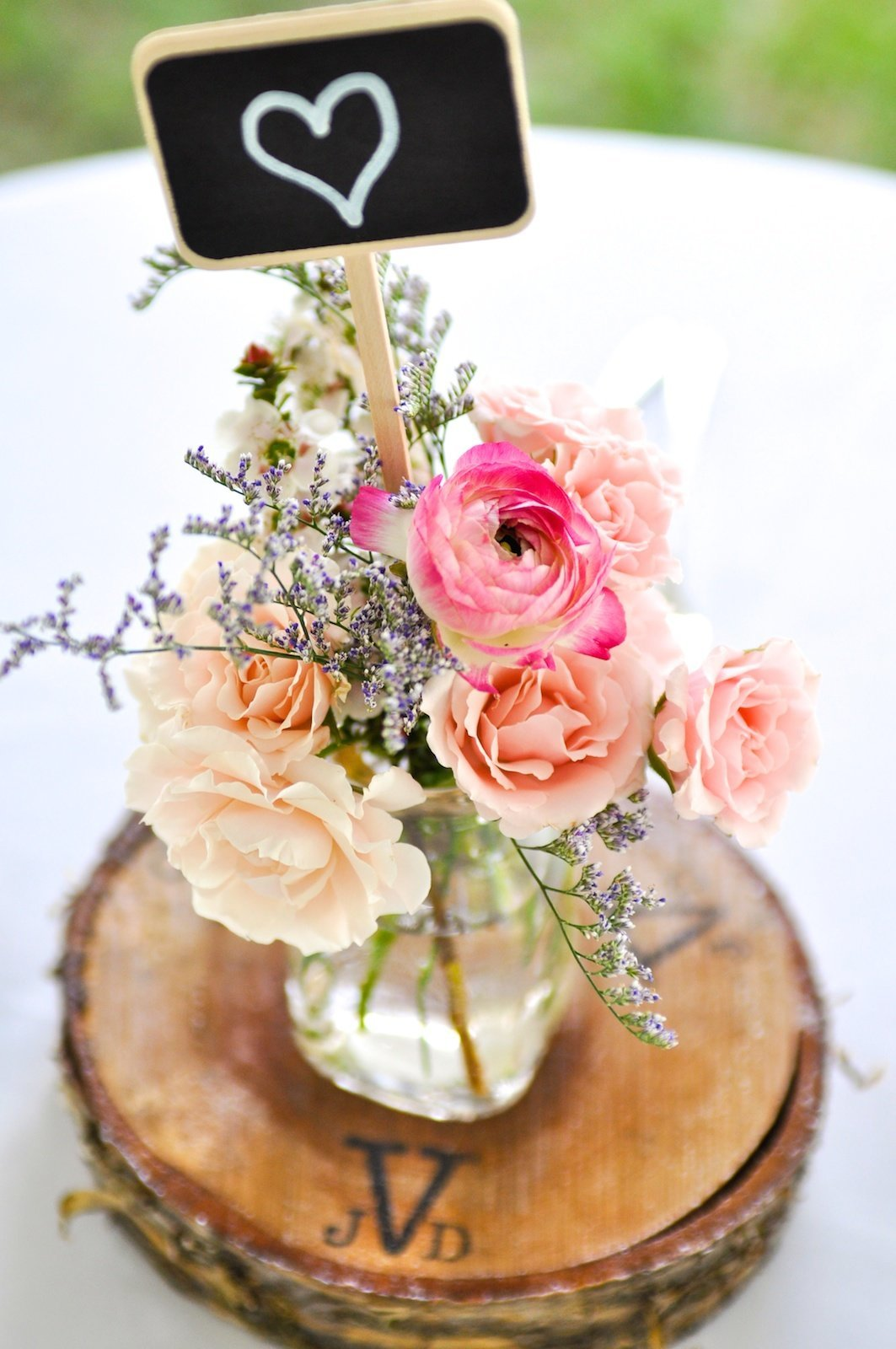 custon DIY wooden centerpieces for this outdoor Vermont wedding