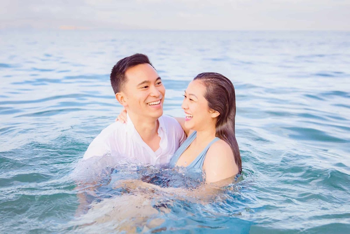 Couple laughing in the water in Wailea
