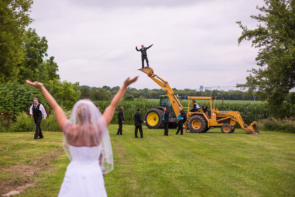 crazy groom riding a backhoe