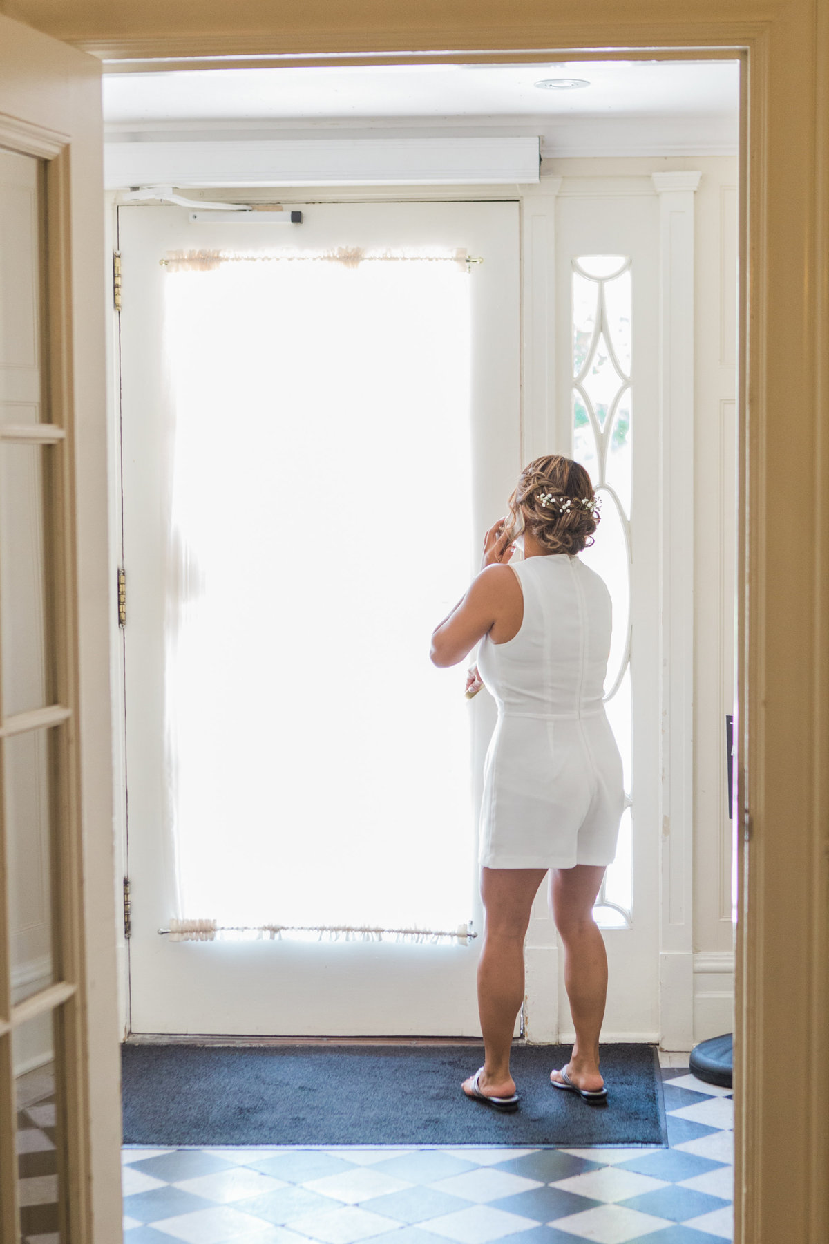 Burlington-Wedding-Photographer-Bride-Looking-Out-Back-Door-of-paletta-mansion