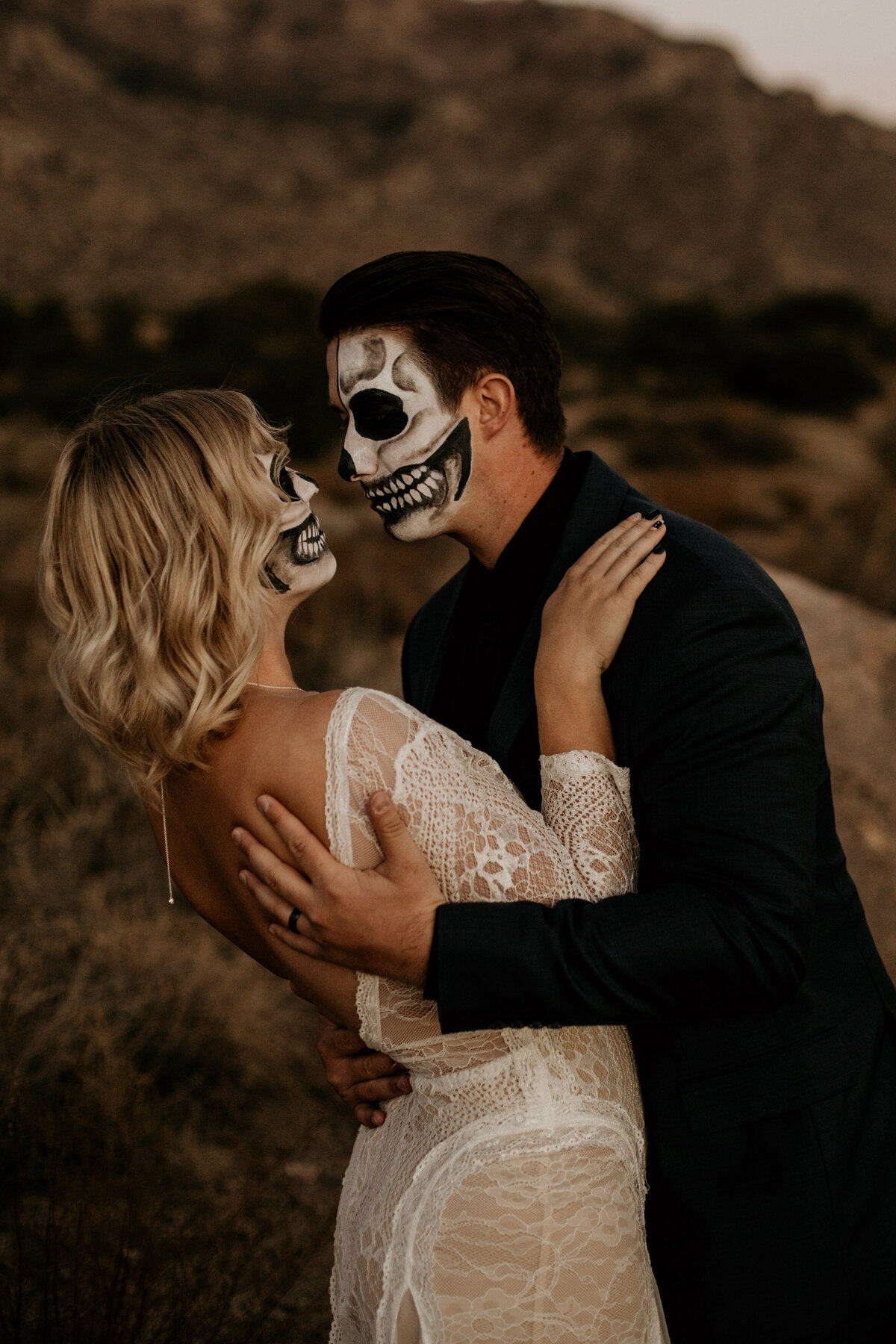 couple with skeleton makeup in wedding attire