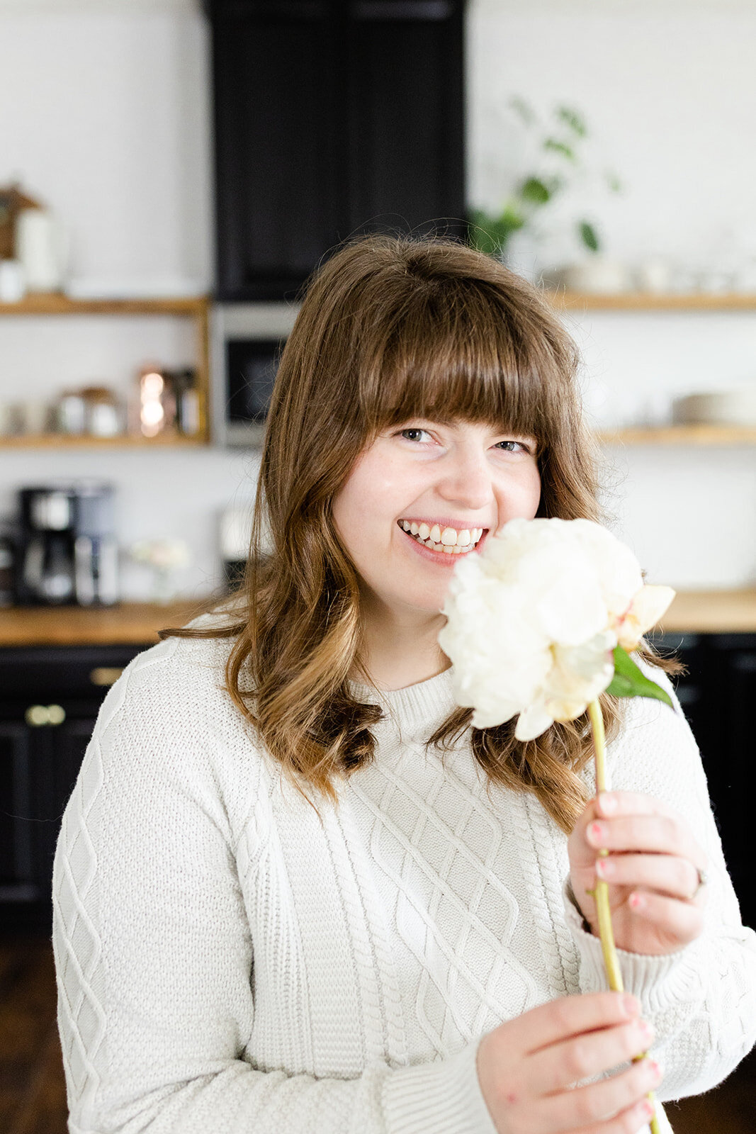 Hannah posing with a flower for branding photographer