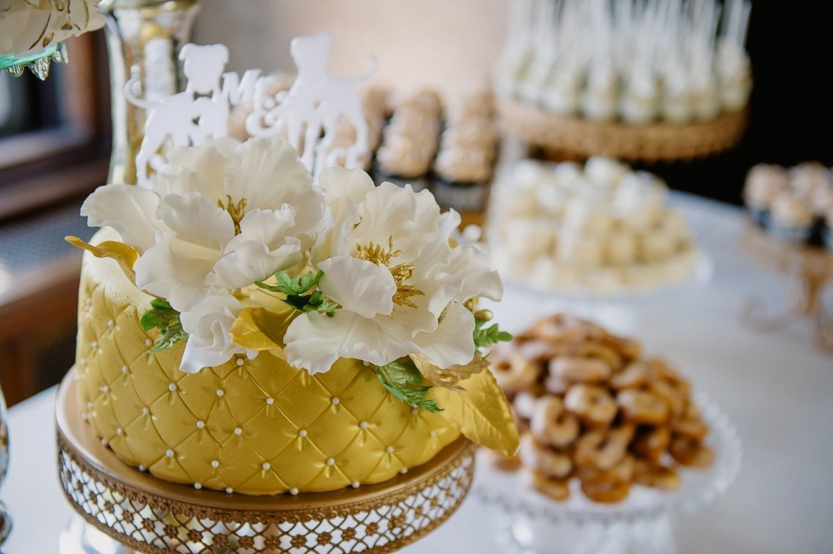 Whippt Desserts and Catering Wedding Cake featuring sugar blooms and sugar filler