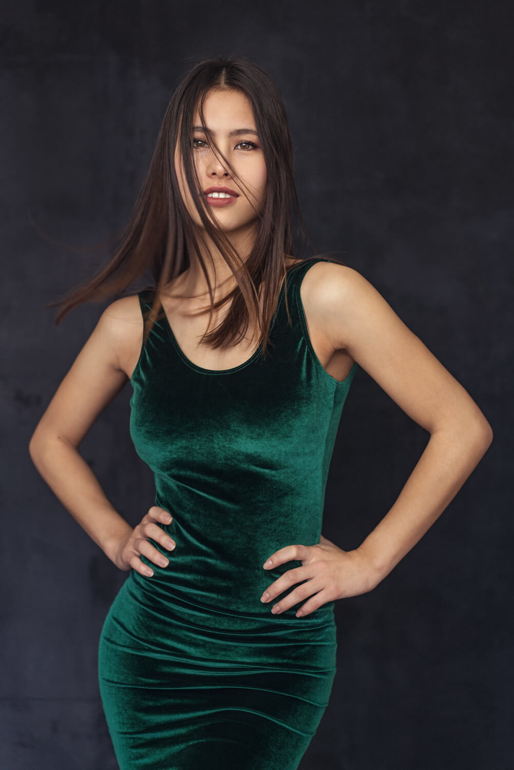 Bethany wearing a striking green dress