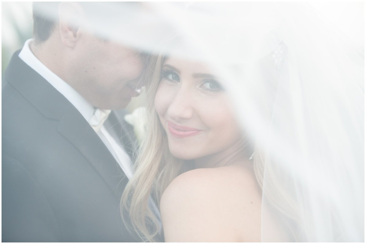 austin wedding photographer vintage villas bride groom under veil 4209 Eck Ln, Austin, TX 78734