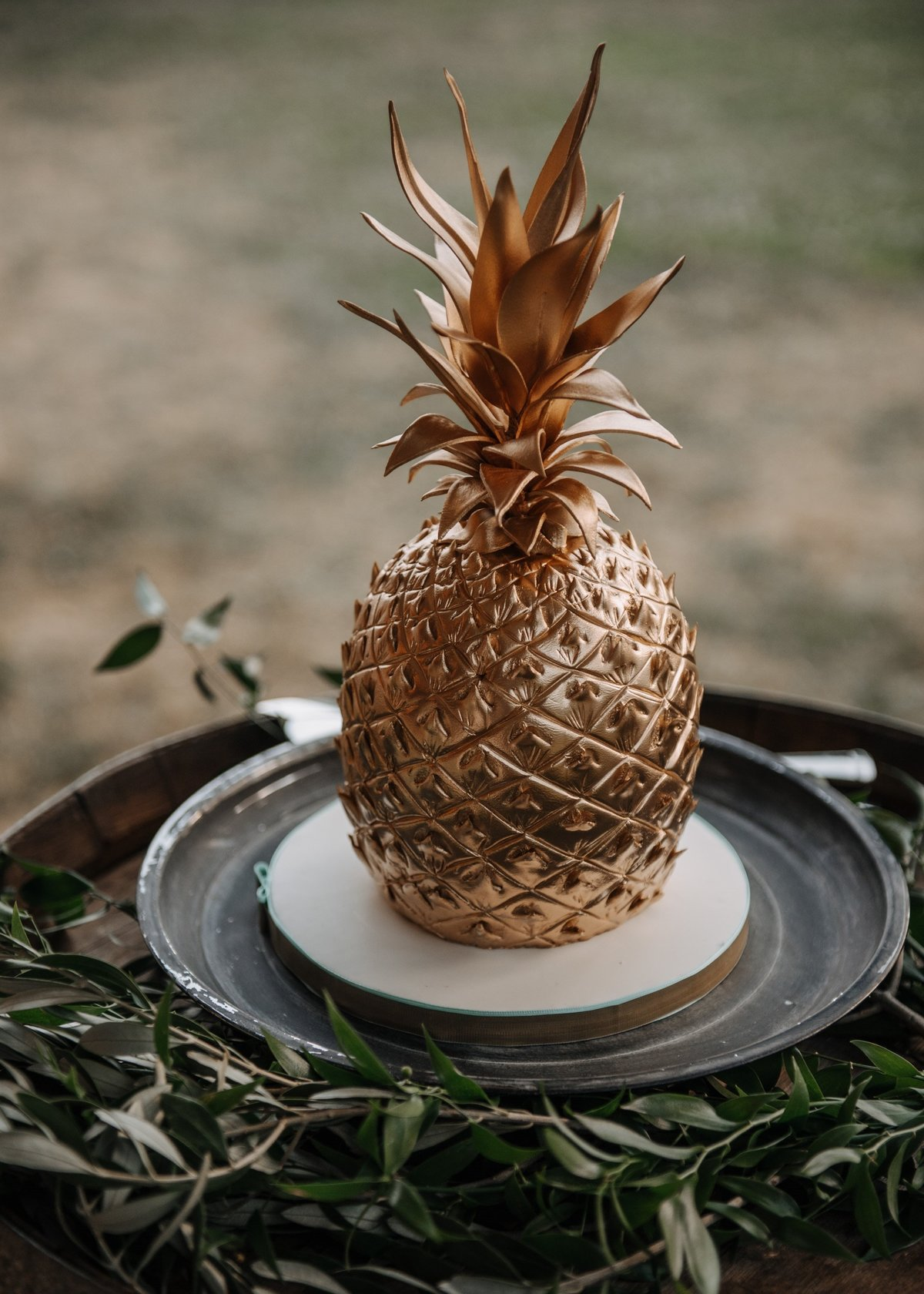 Gold pineapple wedding display cake
