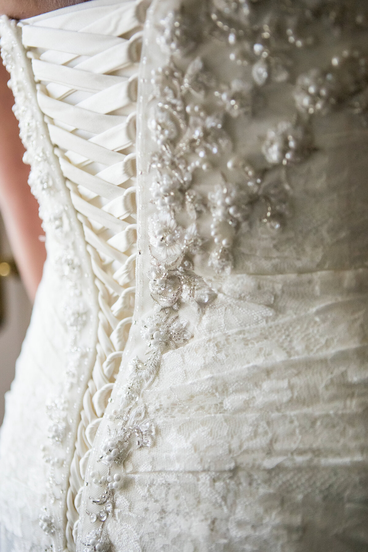 close up of lace up wedding dress