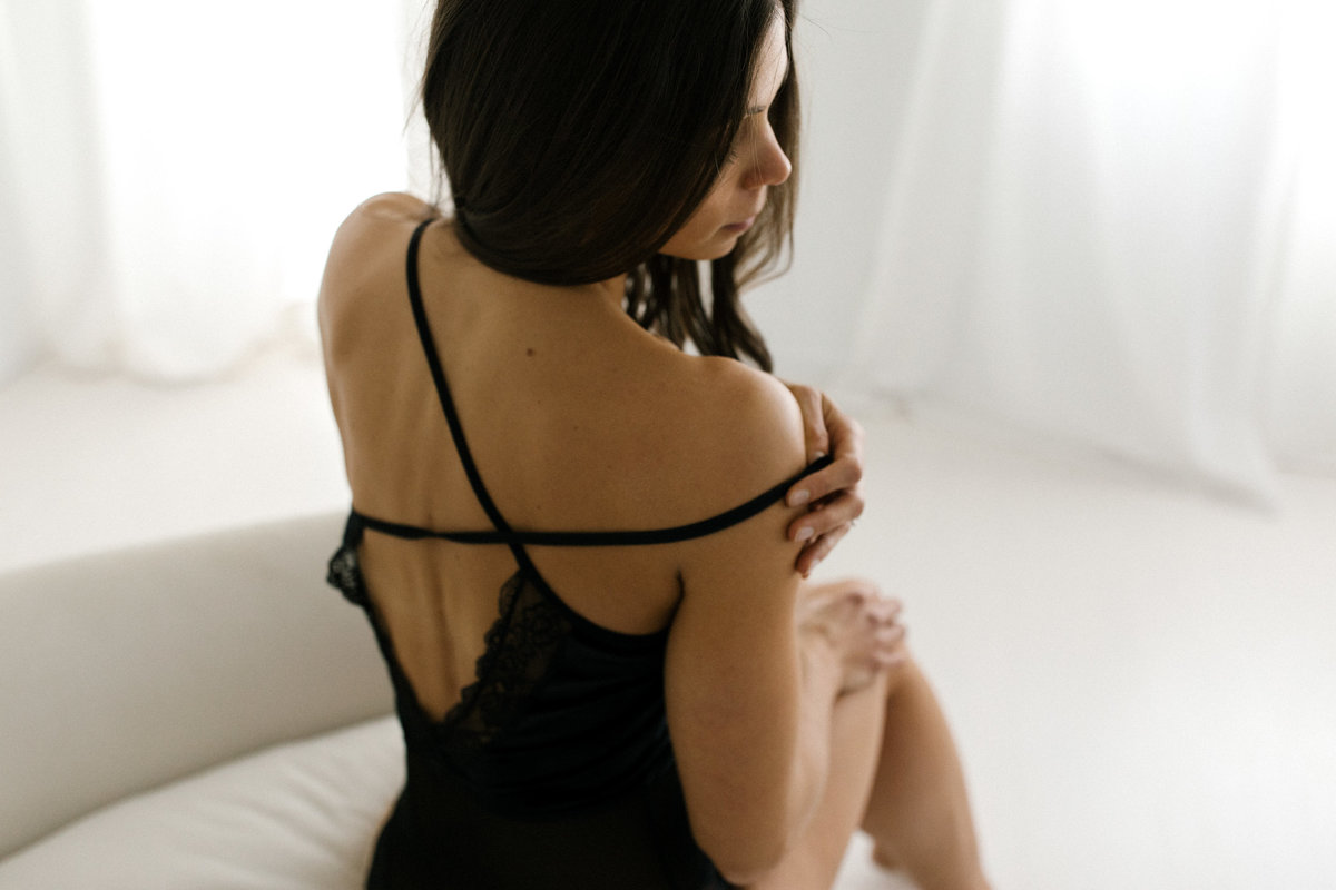 woman sitting on a chair during boudoir session