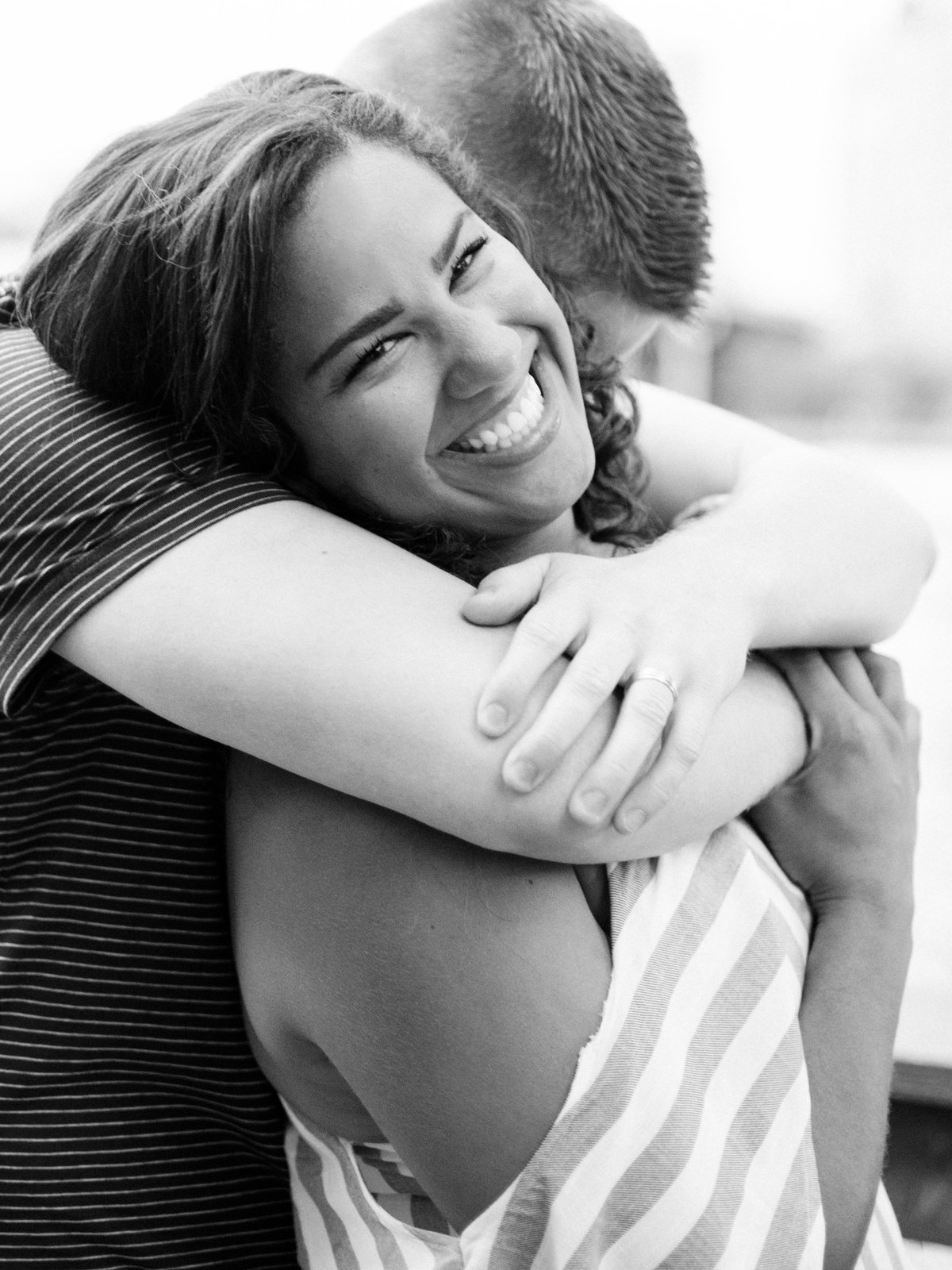 fiance hugs over shoulders of girl in minneapolis summer engagement session
