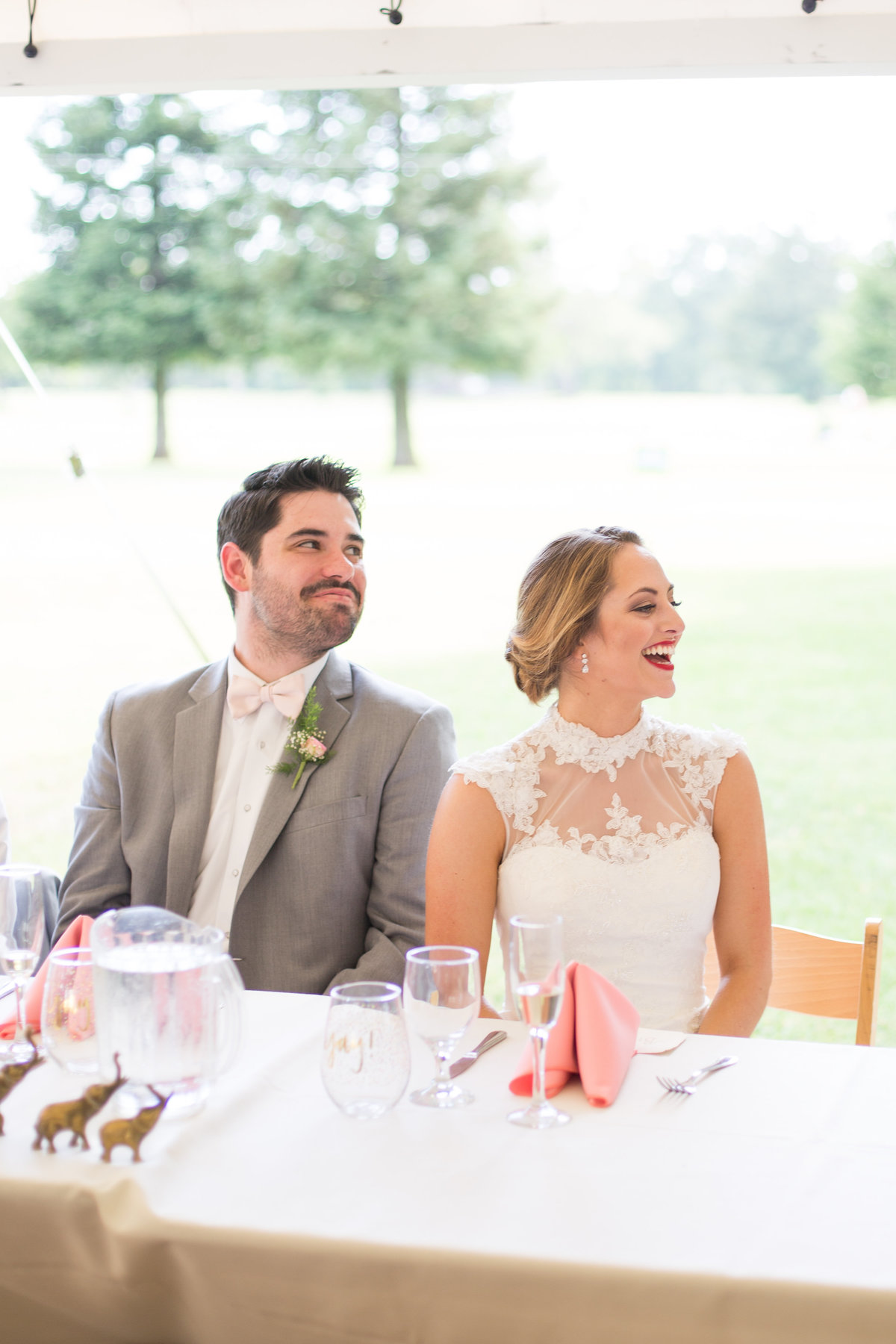 newlyweds laugh during toasts at their wedding in northern california