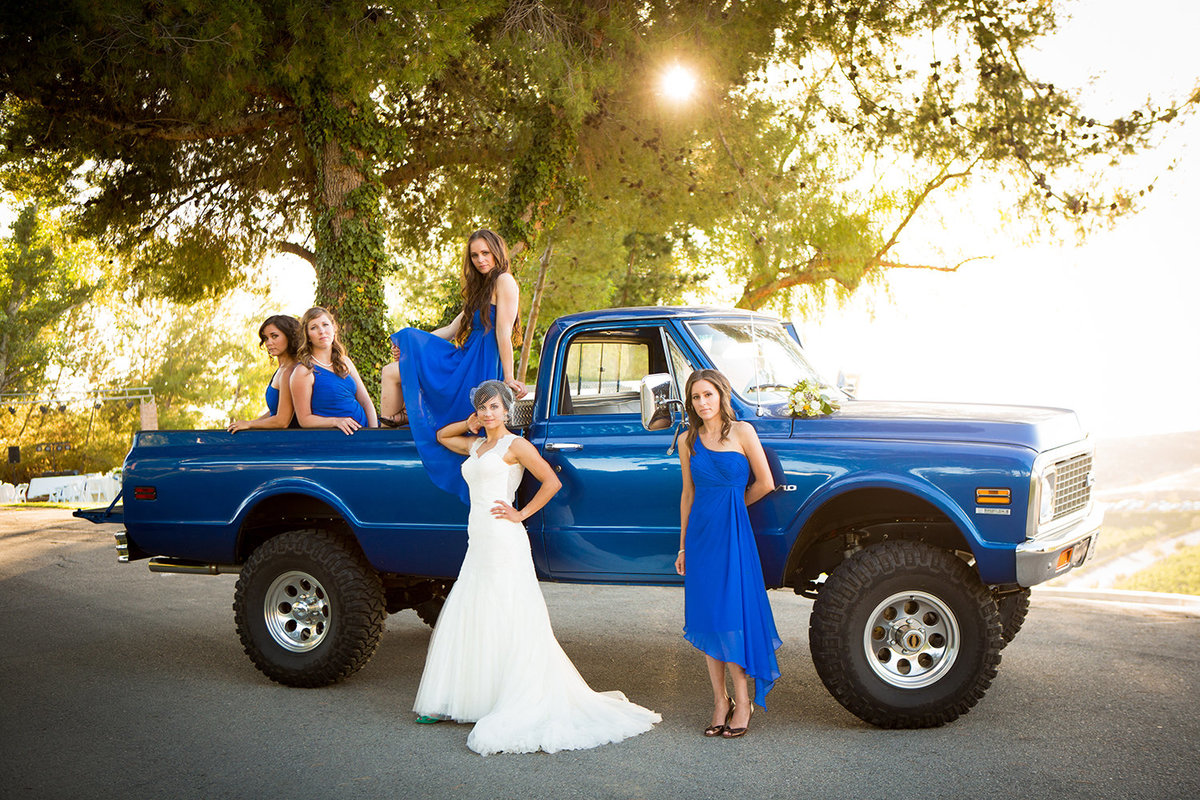 wedding photos bride and bridesmaids with monster truck