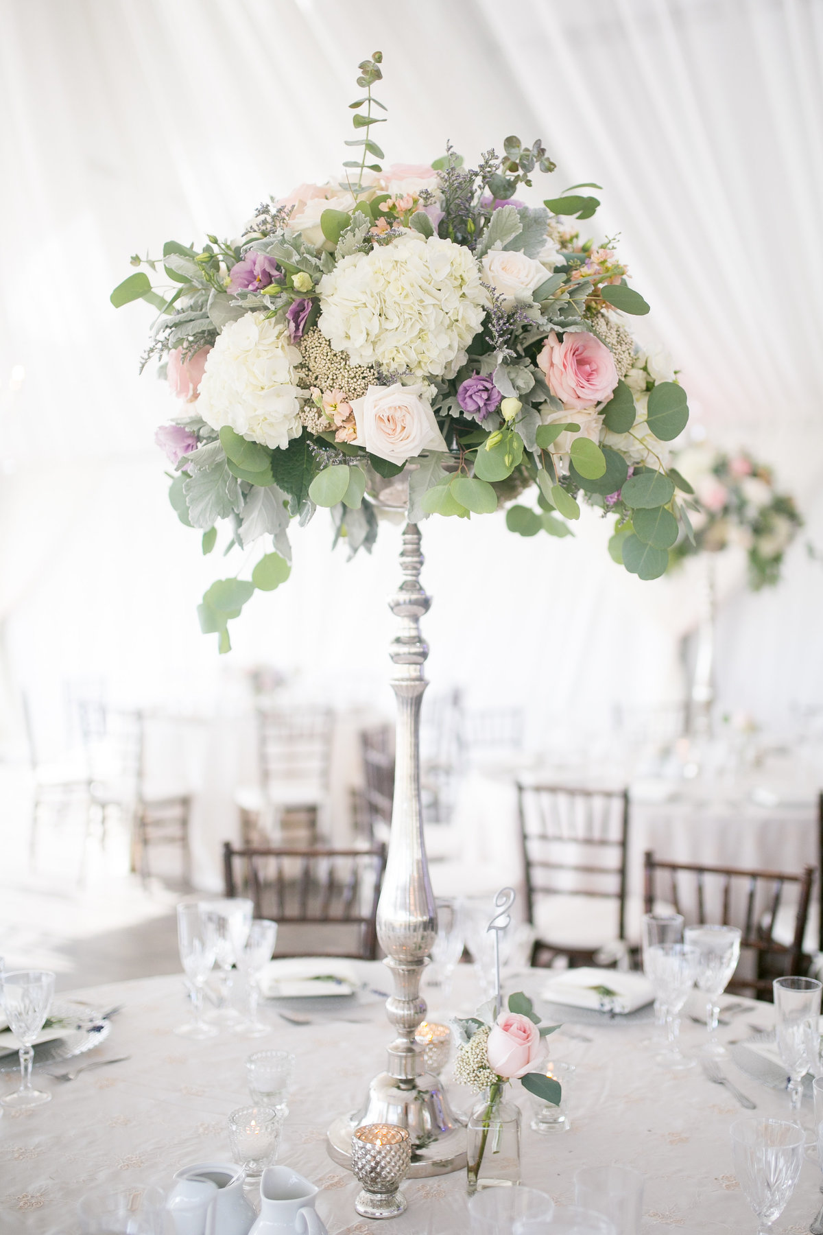 Tall floral centerpiece at wedding reception