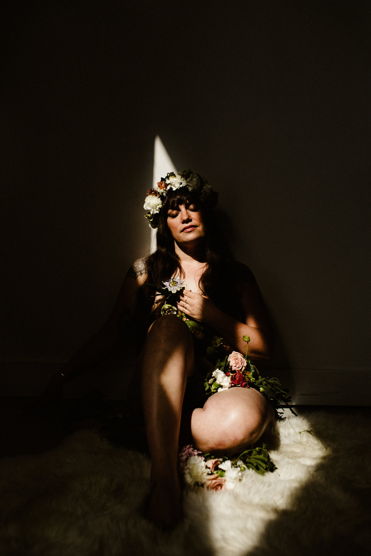 nude woman covered in flowers