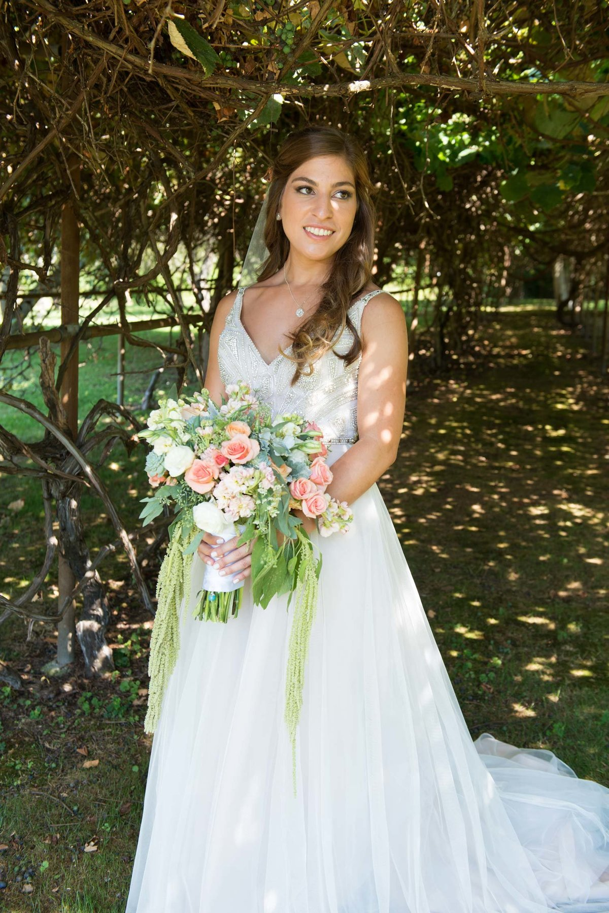 Bride outside holding bouquet at Flowerfield