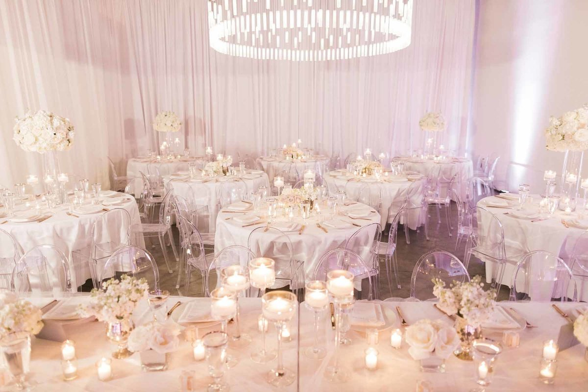 Truly a romantic look achieved with clear ghost chairs and all white floral