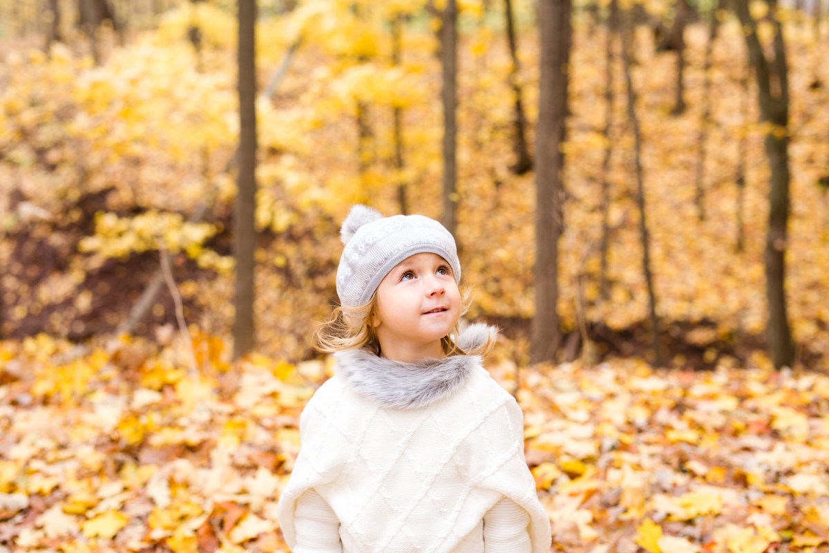 little girl looking in wonder at fall foliage {Etobicoke Family Photographer}
