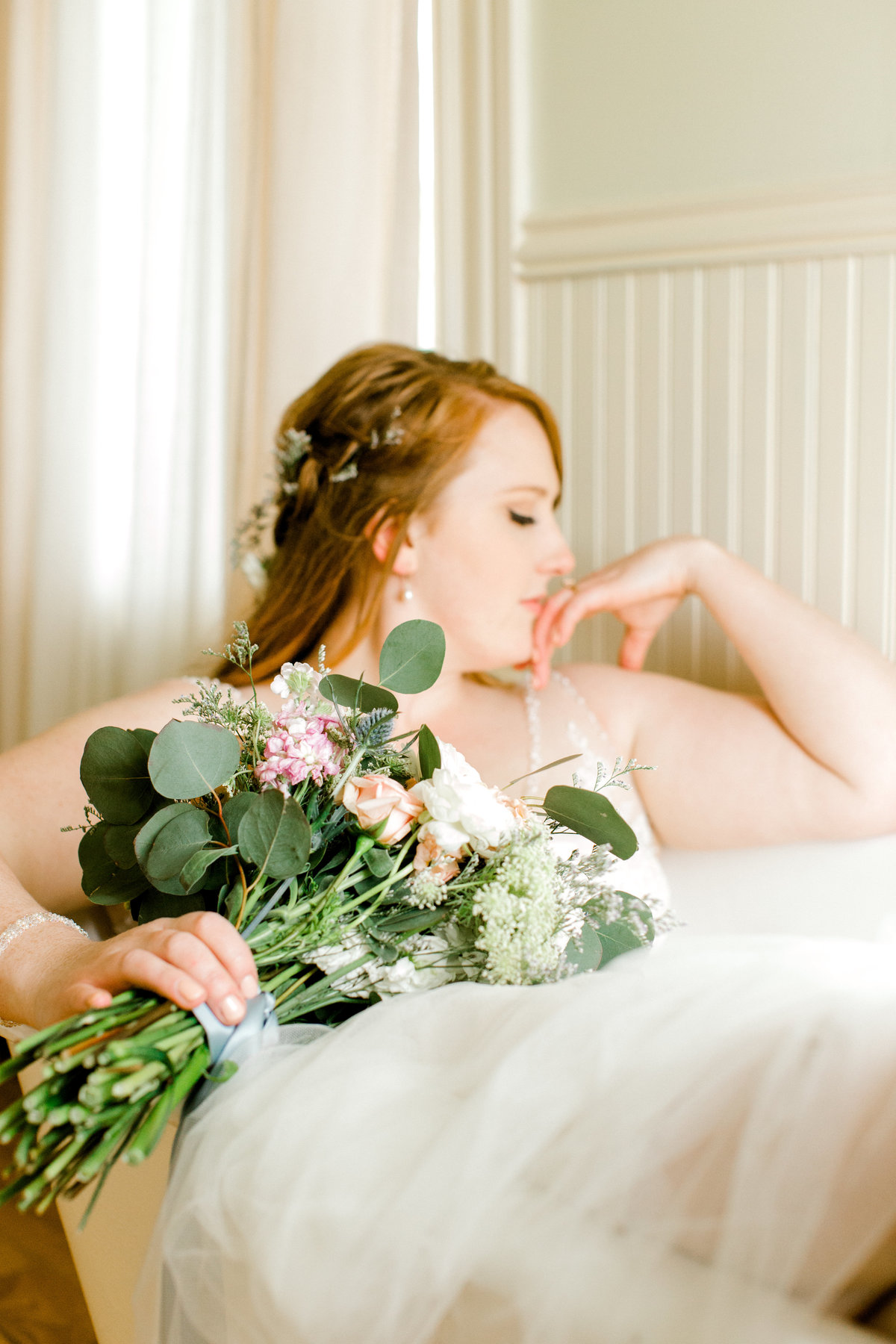 Bride posing in claw foot white tub at Olympias Valley Estate in Petaluma California
