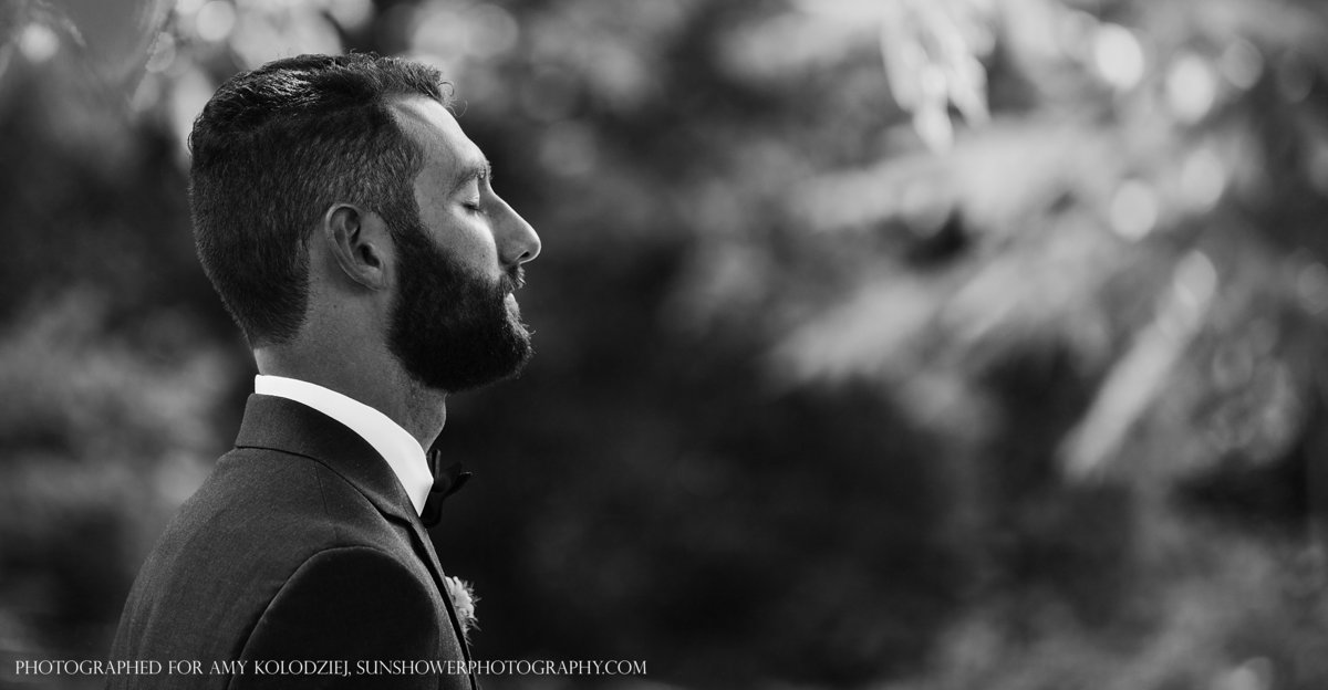 charlotte wedding photographer jamie lucido captures the groom's quiet reflection as he awaits his bride during their first look