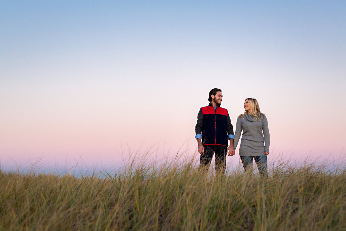 Plum Island MA and it's tall grass is the setting for this romantic couple's engagement session