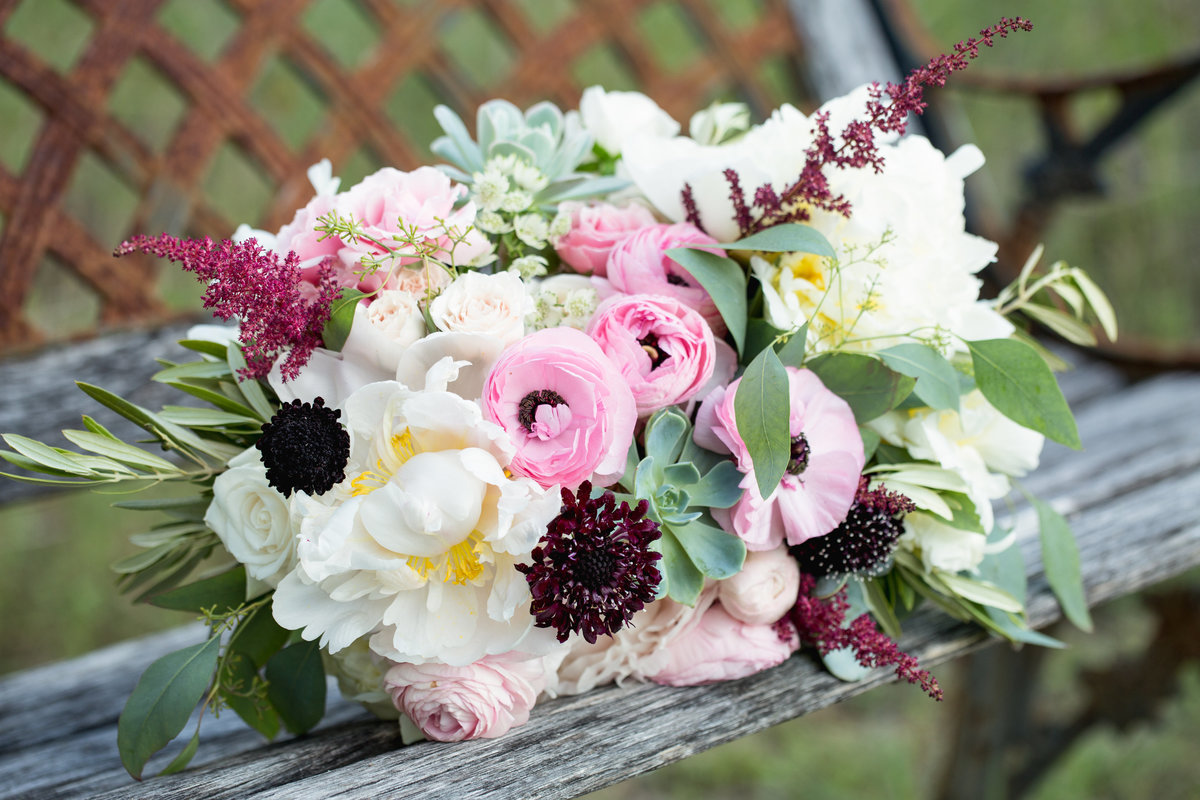 camp lucy wedding photographer bride bouquet 3509 Creek Rd, Dripping Springs, TX 78620