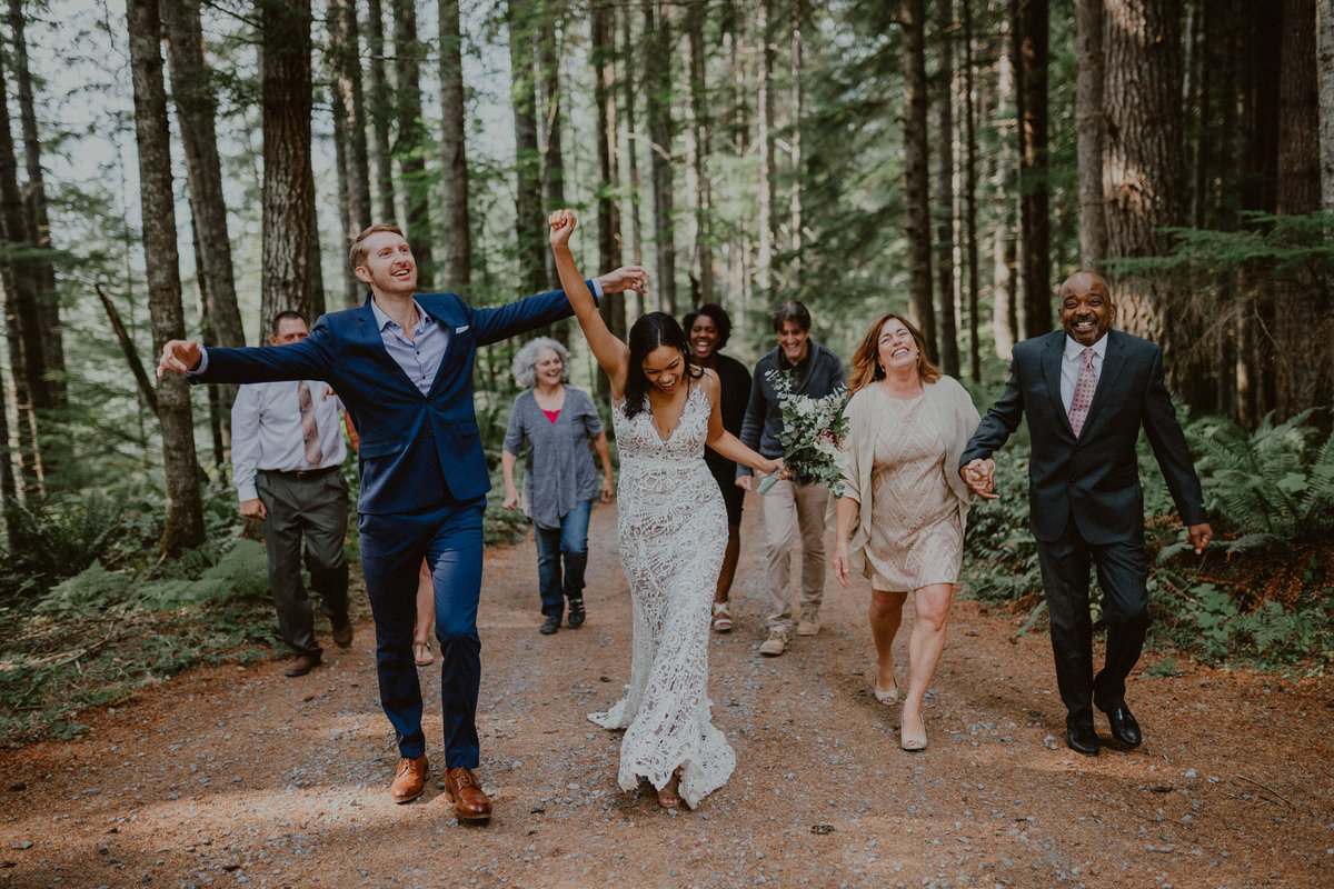 bride and groom dance and celebrate at a fun forest wedding in mount rainier national park seattle washington