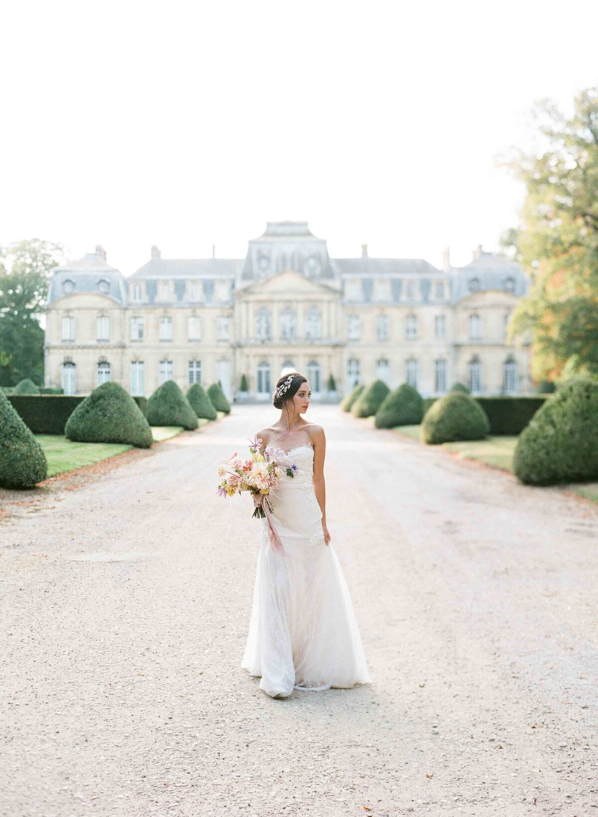 Luxury bride in fron of Chateau de Champlatreux near Paris France