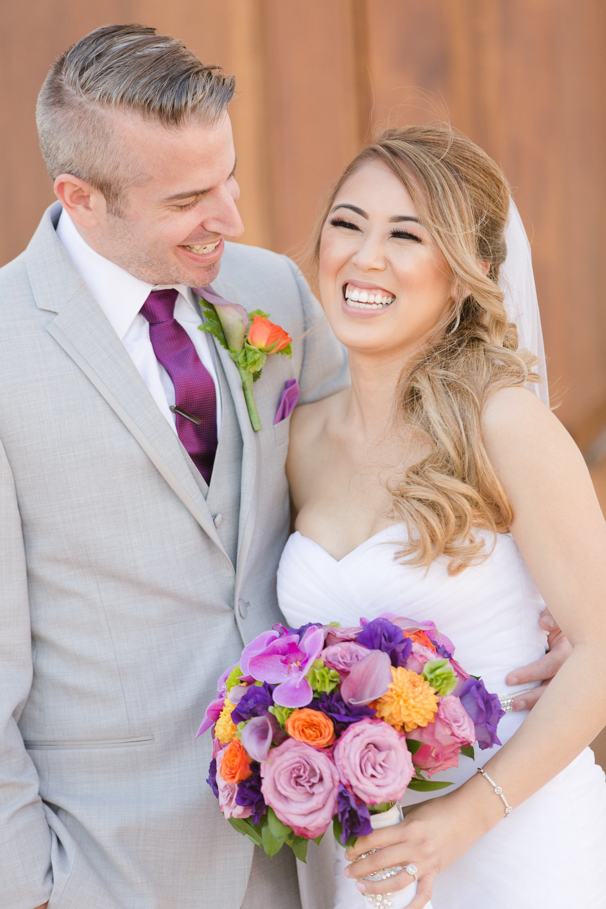 Groom and bride smiling during their first look in the villa de amore garden by matty fran photography