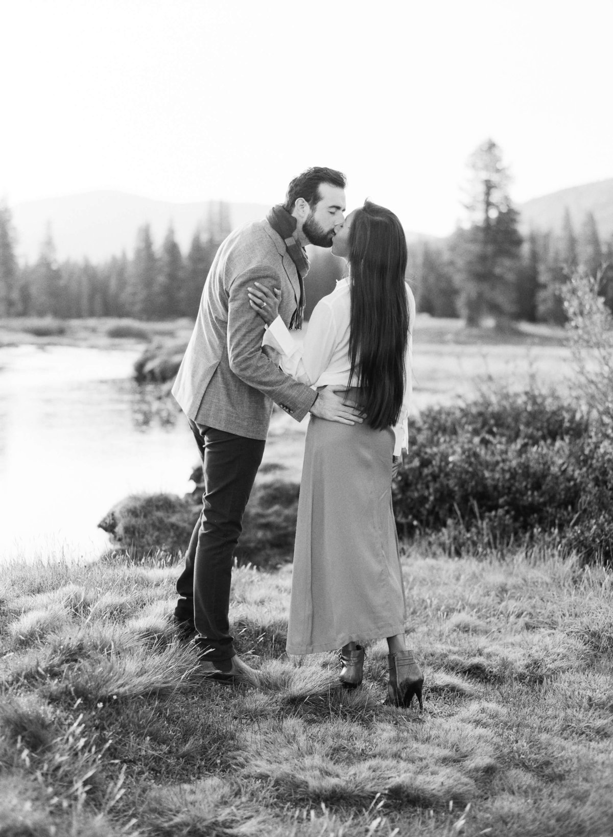 19-KTMerry-destination-engagement-couple-kissing-Yosemite