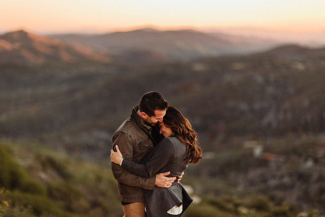Couple embraces during their Julian, Ca engagement session.