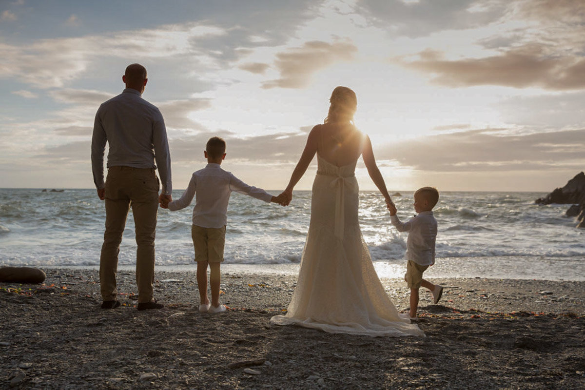 Family wedding photo at Tunnels Beaches