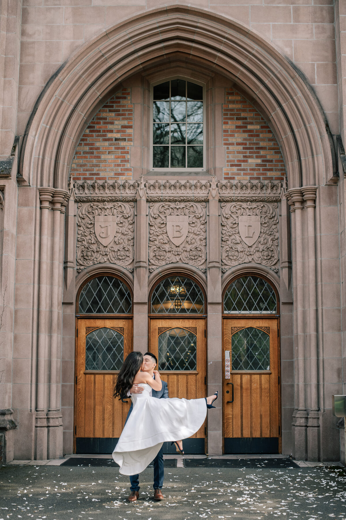 Groom holding bride dancing at University of Washington in Seattle