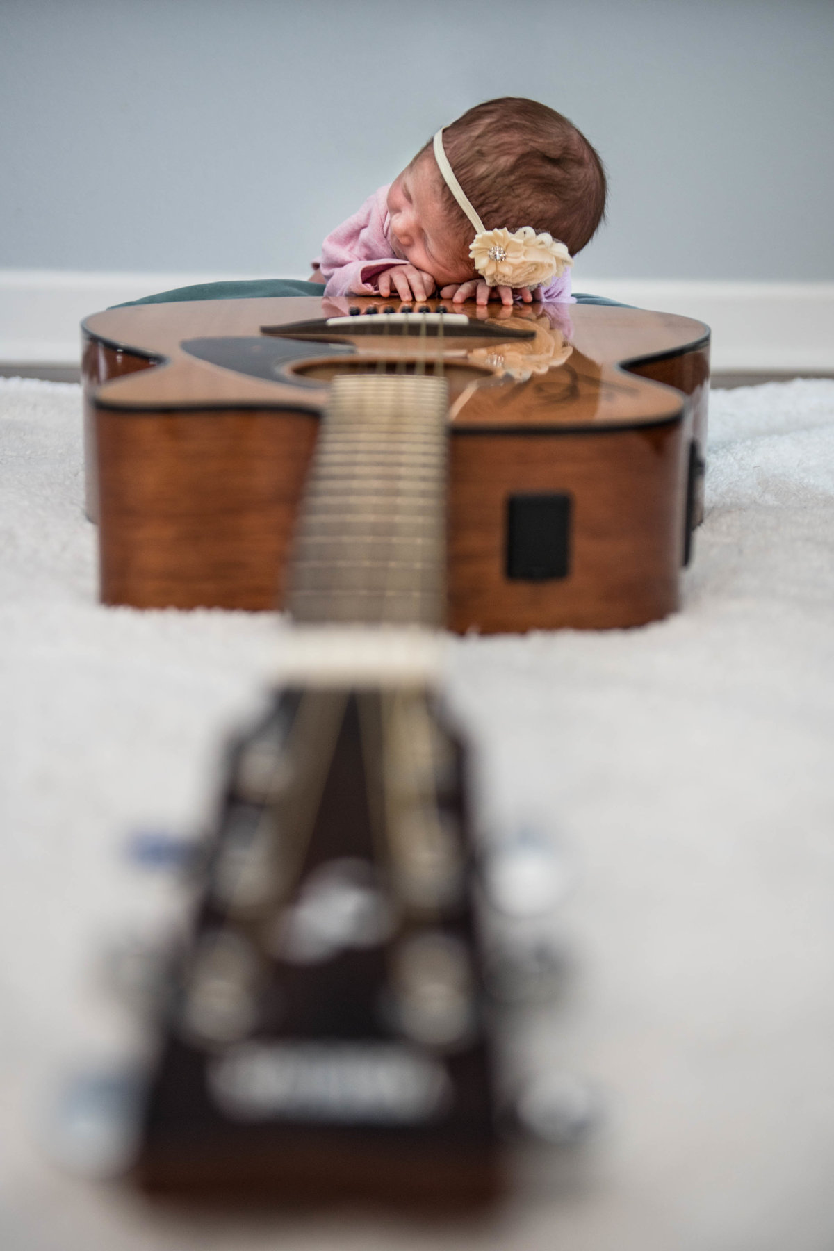 Baby sleeping on a guitar