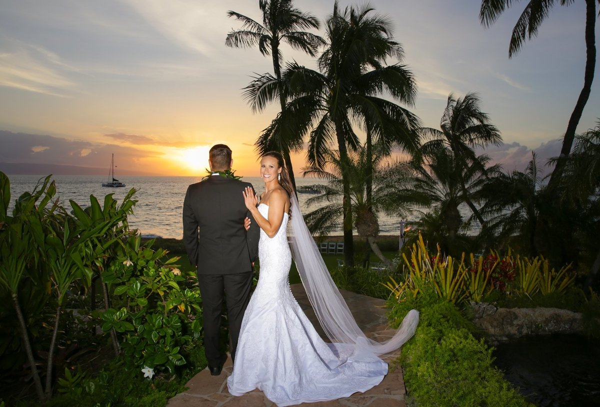 Maui Wedding Photography at The Westin Maui Resort and Spa of the  bride and groom posing at sunset