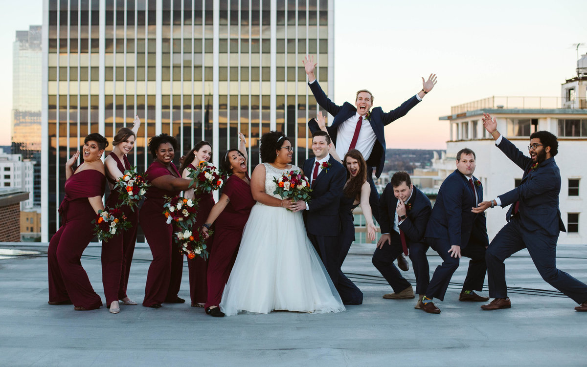 black-and-white-couple-jewish-bridal-party-friends-jump-little-rock-wedding