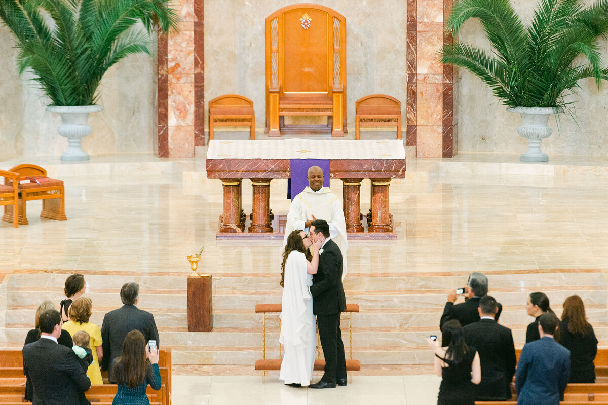 Cathedral of the Sacred Heart Houston, Texas Wedding first kiss