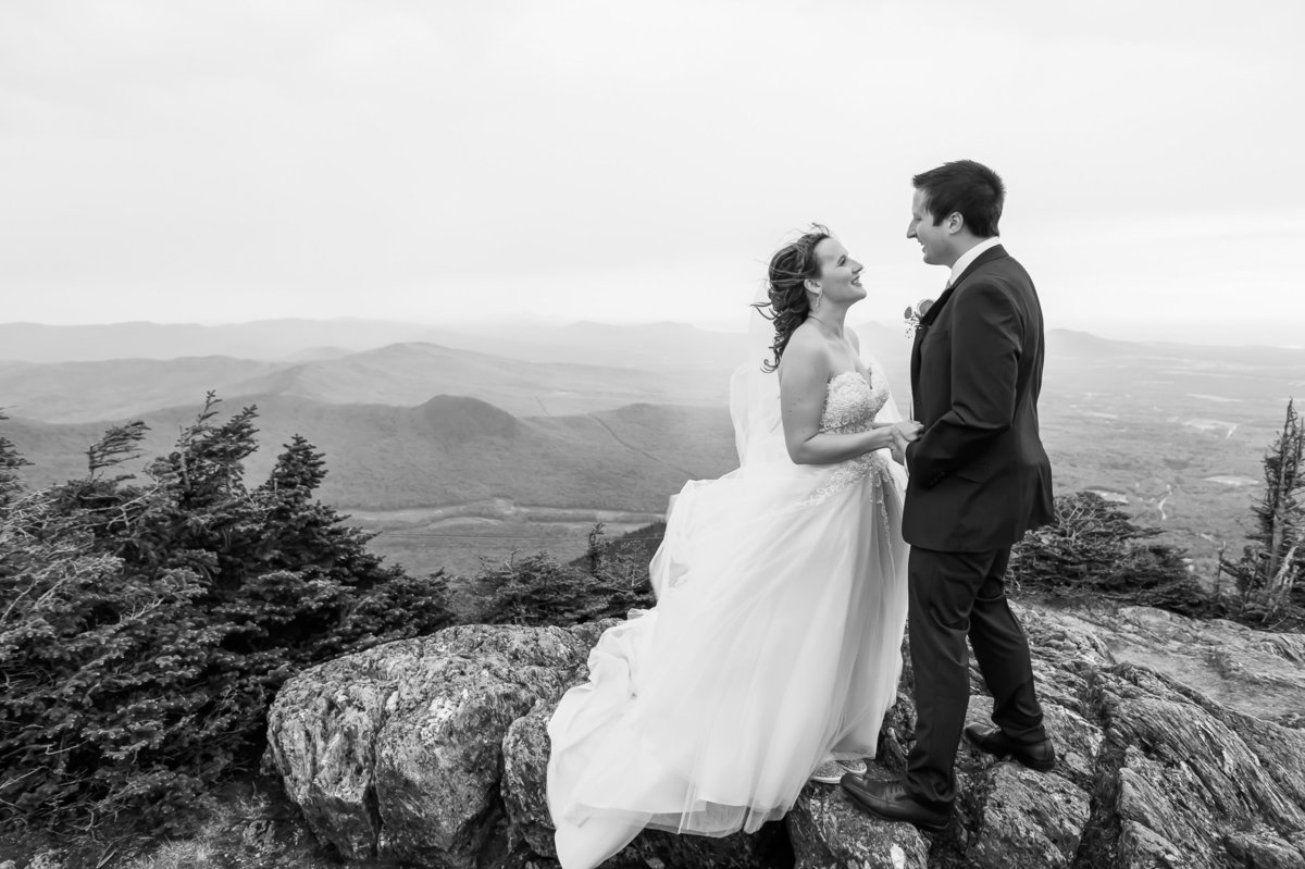 Destination wedding photo with bride and groom on top of Jay Peak at Elevation 4000