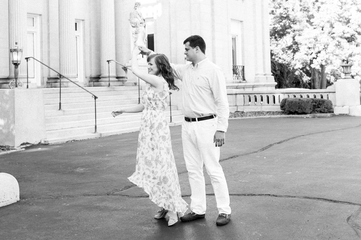 A couple dance together during their engagement session at Laurel Court in Cincinnati, Ohio