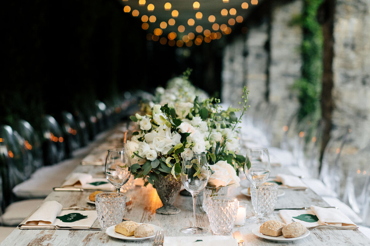 Lake Como Wedding Reception white florals long table under roof of lights