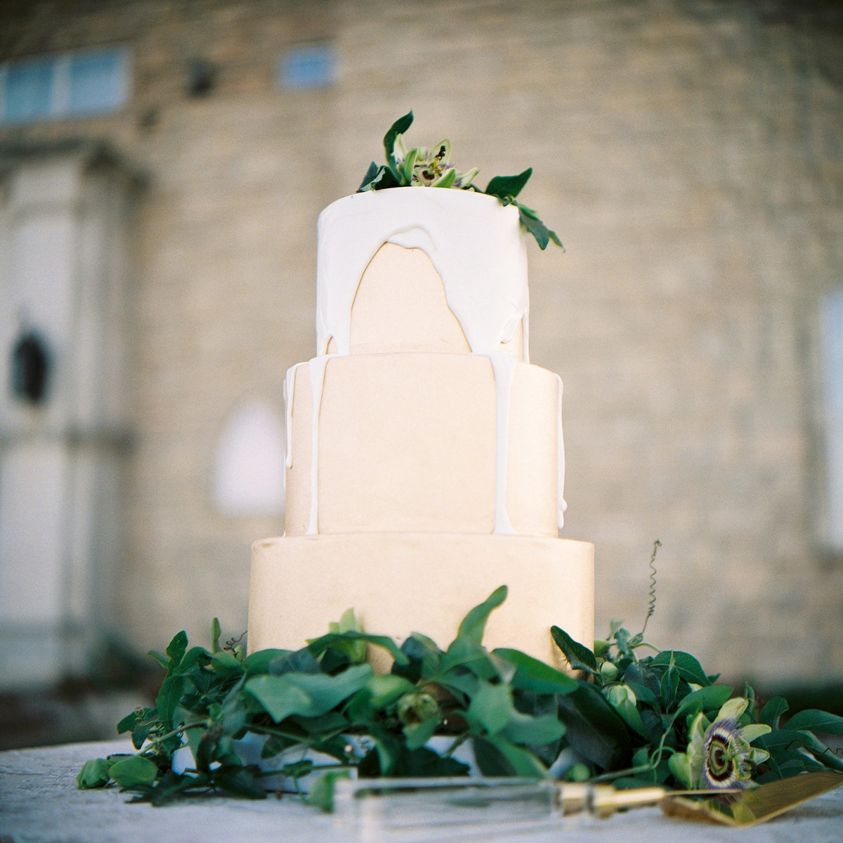 gold and green wedding cake on film