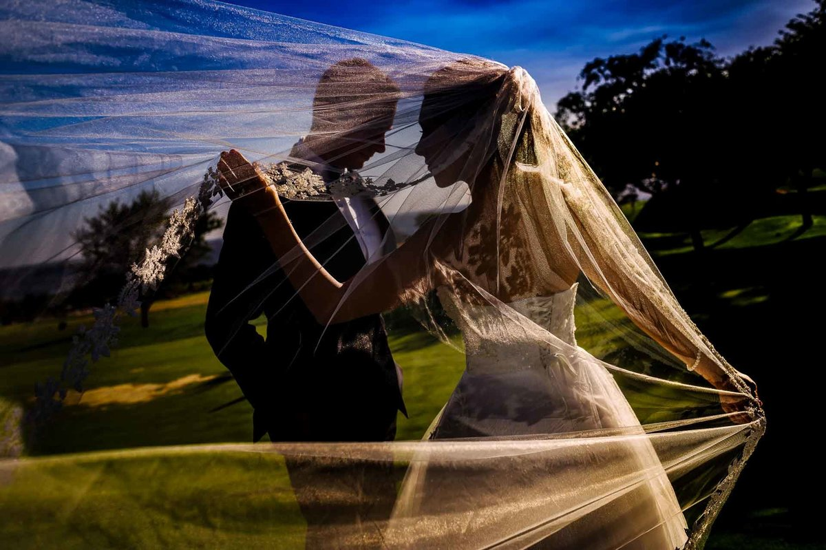 bride and groom portrait with veil flying  at coronado country club in el paso by stephane lemaire photography