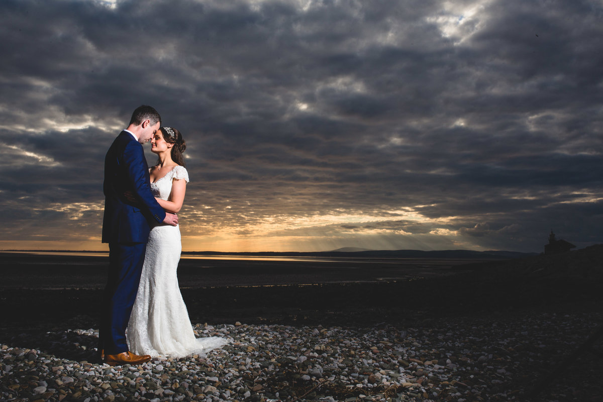 sunset portrait of a bride and groom on the beach at the midland hotel