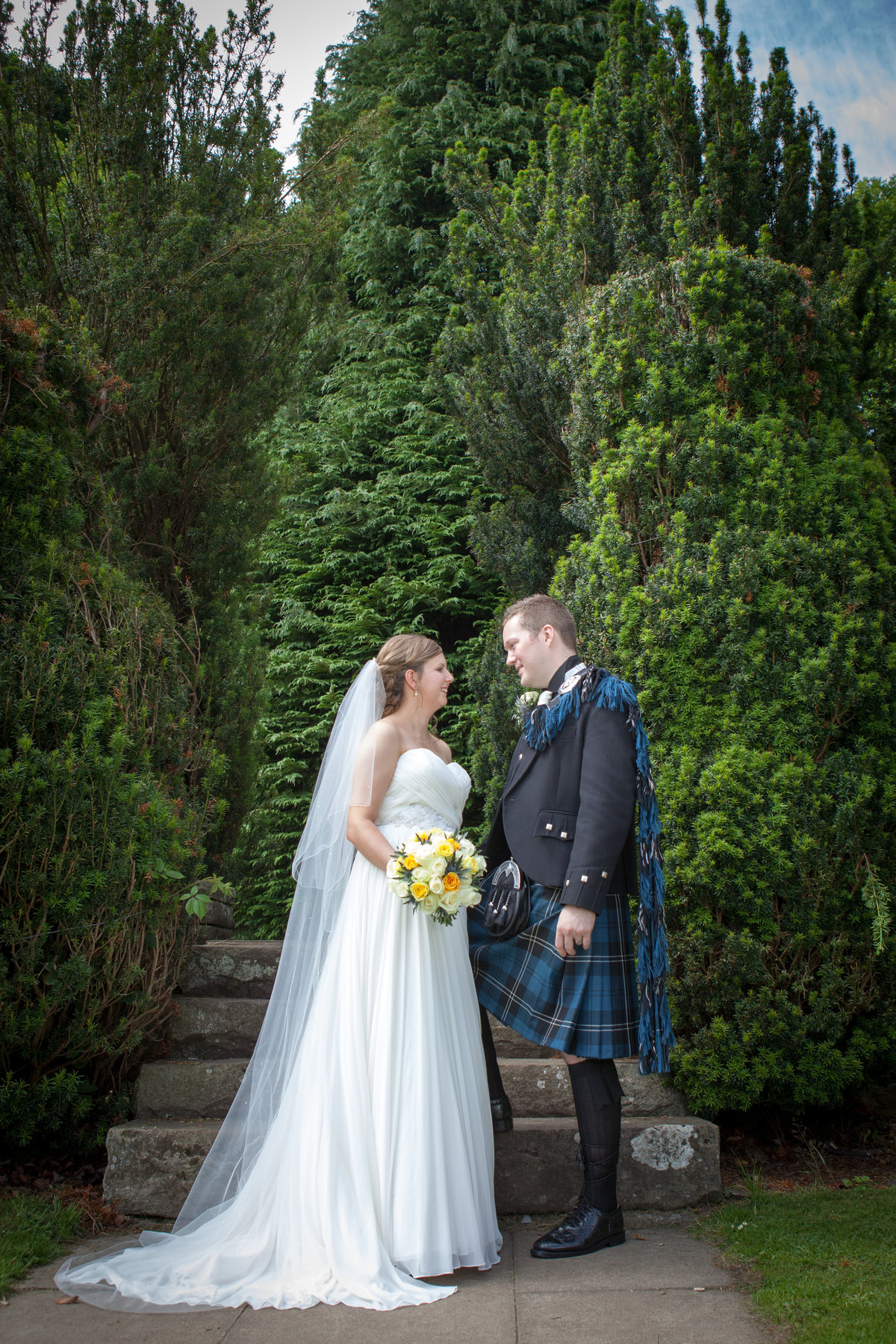 Full Length colour portrait of bride and groom