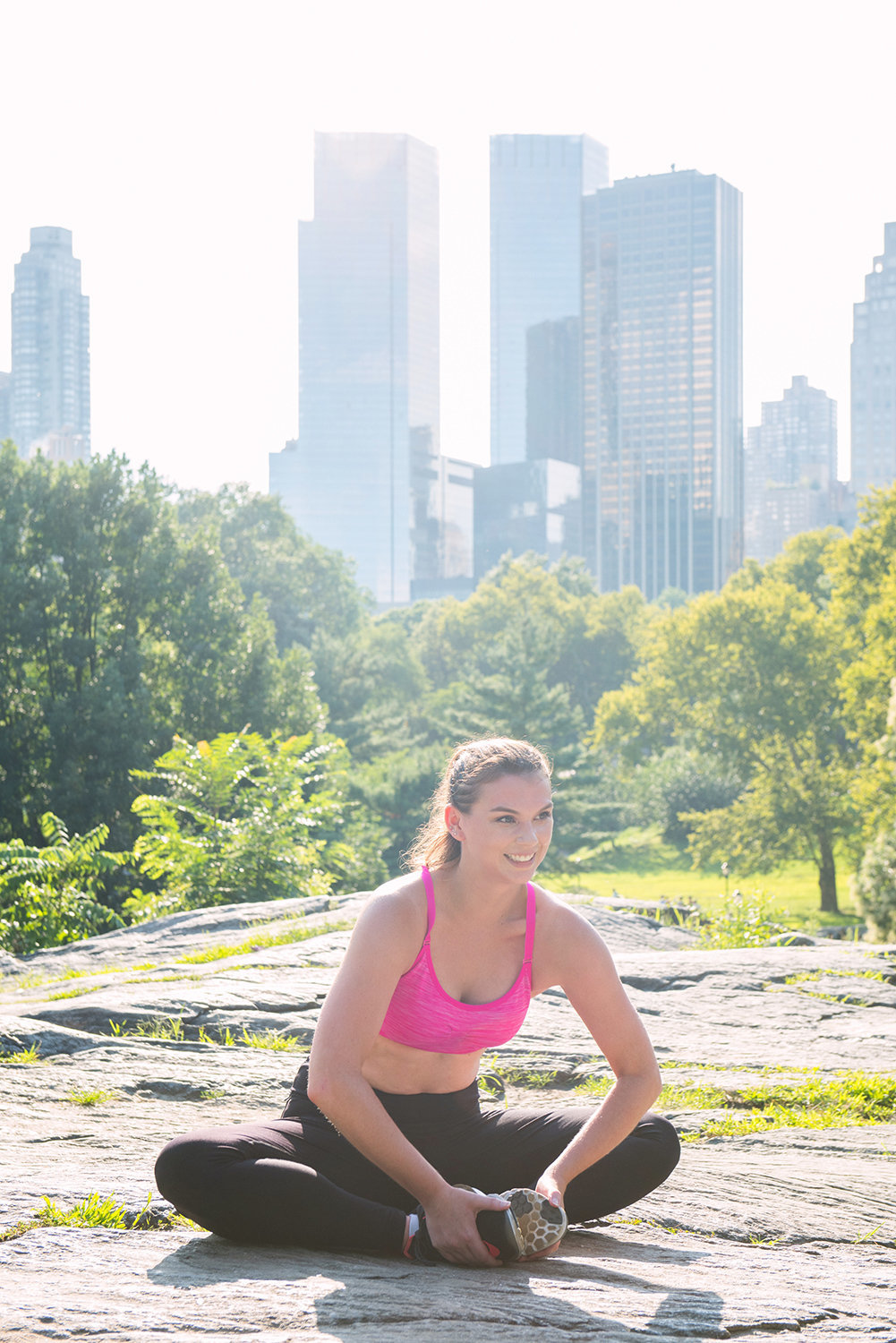 woman central park new york butterfly stretch cobblers pose Baddha Konasana Bound Angle Pose
